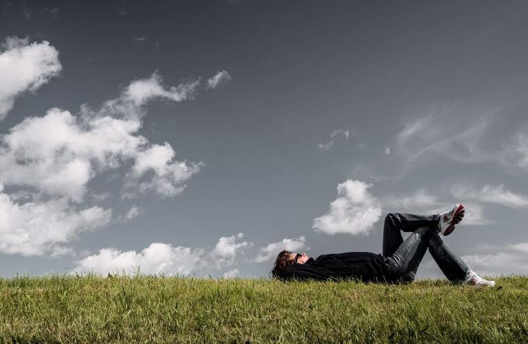 A Man lies on a medow